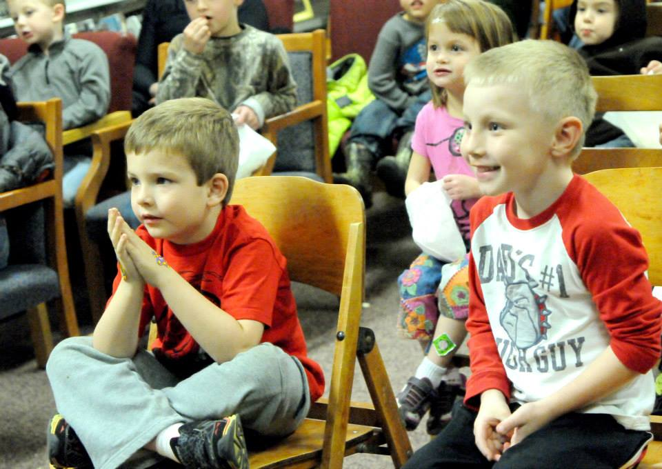 Children gathered at the St. Maries Library Thursday to watch Cecil the Magician perform magic tricks during the library's family night in celebration of Idaho Family Reading Week, November 2013.
